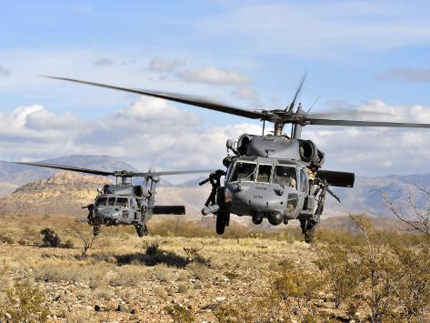 Two HH-60 Pavehawk Helicopters Preparing to Land Photographic Print