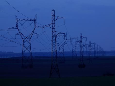 Tall Towers Supporting Power Lines in a Dark Blue Sky Photographic Print