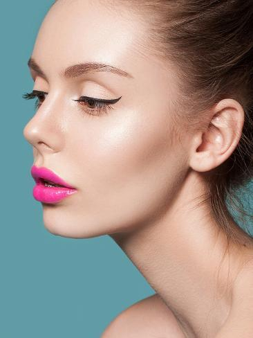 Beautiful Young Woman with Pink Lips and Healthy Skin on a Blue Background. Trendy Summer Makeup Photographic Print