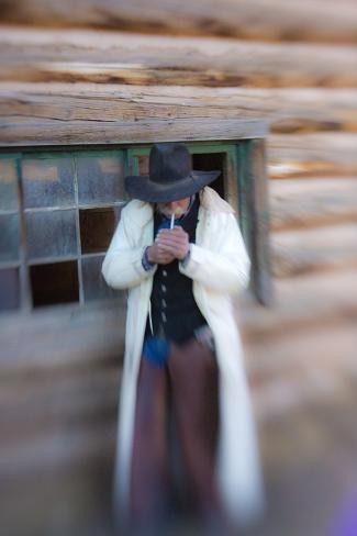 Cowboy Lighting a Cigarette Stampa fotografica