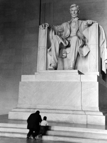 Black Man and Small Boy Kneeling Prayerfully on Steps on Front of Statue in the Lincoln Memorial Photographic Print