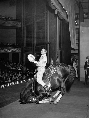 Gene Autry Astride His Famous Horse Champion on Bent Front Knees, Touching Head to Floor, on Stage Premium Photographic Print