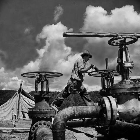 Worker Opening up a Pipeline to Let the Oil Flow Photographic Print