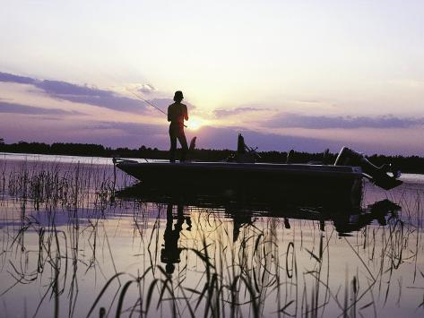 Man Standing in Boat Fishing Photographic Print