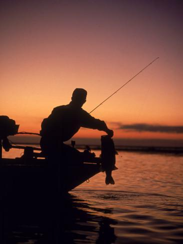 Silhouette of Bass Fisher at Sunset Photographic Print