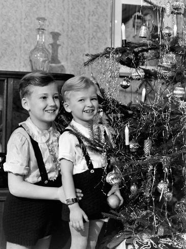 Two Brothers Look at a Christmas Tree in their Living Room in Germany, Ca. 1949 Photographic Print