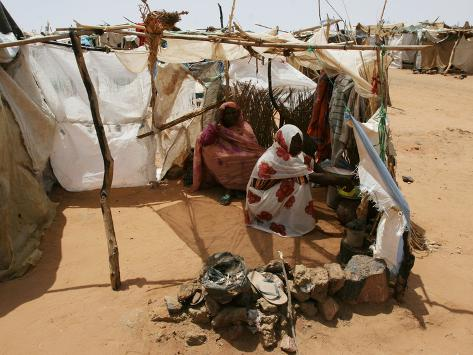 Two Sudanese Women Sit at a Make Shift Hut Photographic Print