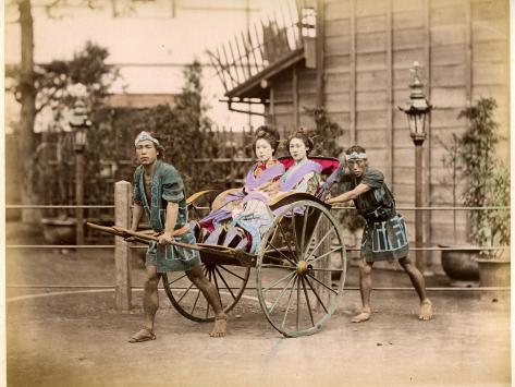 Two Well-Dressed Japanese Ladies Take a Ride in a Rickshaw Powered by Two Rickshaw Drivers Stretched Canvas Print