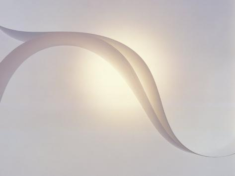 Two White Fabric Streamers Drifting in Pale Grey Sky with Strong Backlight Photographic Print