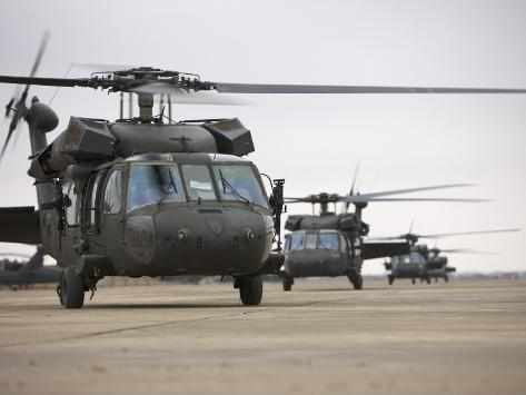 UH-60 Black Hawks Taxis Out for a Mission over Northern Iraq Photographic Print