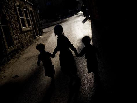Ultra-Orthodox Jewish Children Walk in a Street in the Mea Shearim Neighborhood in Jerusalem Photographic Print