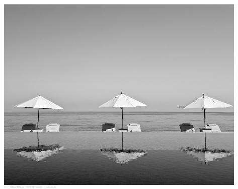Umbrellas by the Sea Art Print