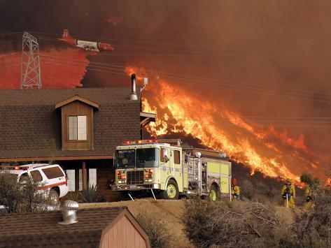 US Forest Service Air Tanker Drops Fire Retardant as the Fire Burns in the Hills Above a Home Photographic Print