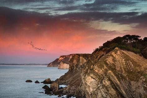 Beautiful Vibrant Sunrise over Rocky Coastline Photographic Print