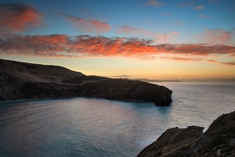 Beautiful Vibrant Sunrise over Rocky Coastline Photographic Print