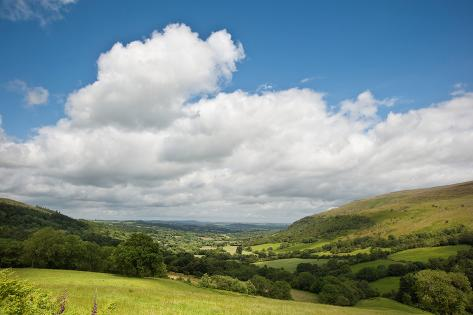 Countryside Landscape Image across to Mountains in Distance with Dramatic Sky Photographic Print