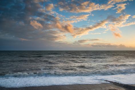 Stunning Vibrant Winter Sunset over Long Exposure Receding Waves Photographic Print