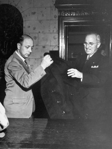 Vice-President Harry S. Truman Checking His Hat and Coat after Arriving at Reception Stretched Canvas Print
