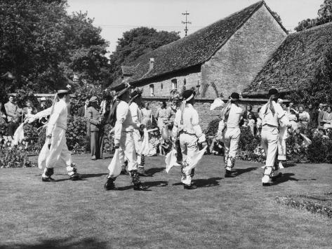 Villagers Watch a Morris Dancing Team Perform on a Well-Clipped Lawn Stretched Canvas Print