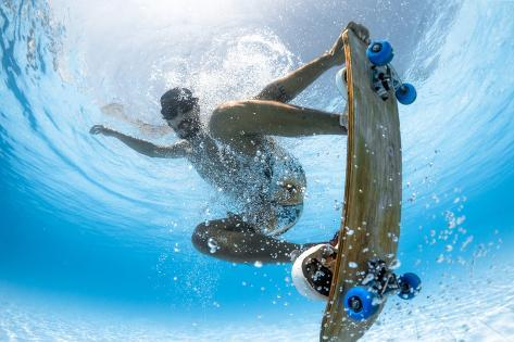 Man Skateboarding Underwater in the Swimming Pool Photographic Print