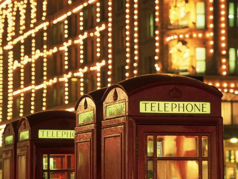 Telephone Booths in Front Store, London, England Photographic Print