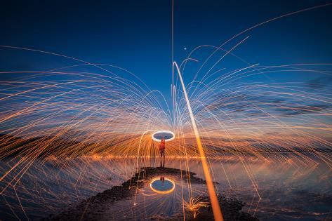 Showers of Hot Glowing Sparks from Spinning Steel Wool on the Rock and Beach Photographic Print