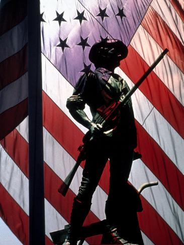 US Flag with Silhouetted Statue of Soldier Photographic Print
