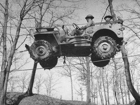 Group of Us Soldiers Pulling a Jeep over a Ravine Using Ropes while on Maneuvers Photographic Print