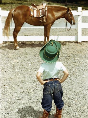 Young Cowboy Looking at Horse Photographic Print