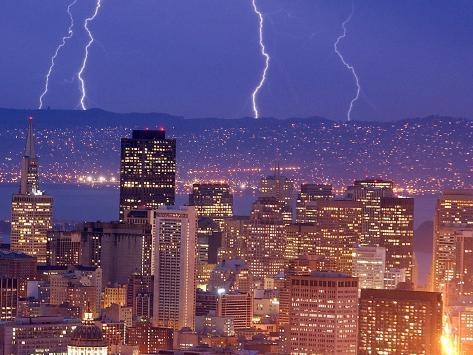 With the San Francisco Skyline in the Foreground, Lightning Strikes Over the Hills of Oakland, Ca Photographic Print
