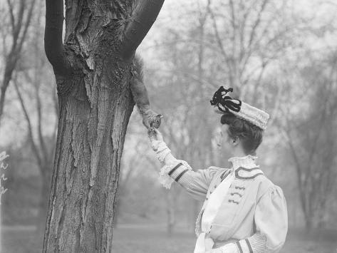 Woman Feeding a Squirrel Photographic Print