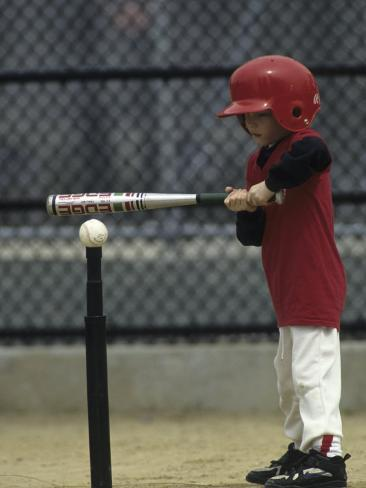 Young Boy Batting During a Tee Ball Game Photographic Print