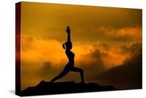 Silhouette of Woman Doing Yoga Meditation During Sunrise with Natural Golden Sunlight on Mountain by szefei
