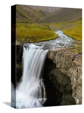 Water Running from Glacier and Waterfall, Iceland by Tom Norring
