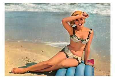 Woman in Two-Piece on Raft by Shore