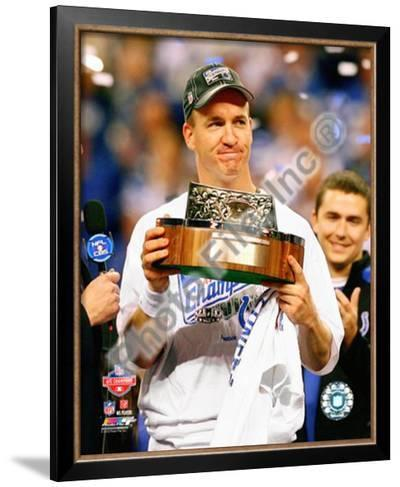 Peyton Manning with the 2009 AFC Championship Trophy