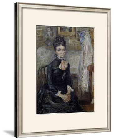 Woman Sitting by a Cradle