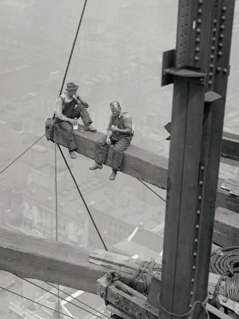 Workers Sitting on Steel Beam