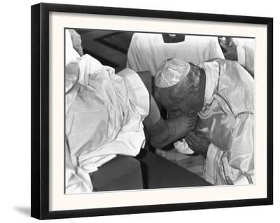 Pope John Paul II Kisses the Feet of One of 12 Mentally Retarded Italians