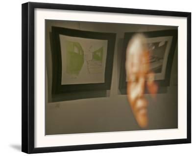 Lithograph by Nelson Mandela is Seen Reflected on a Photographic Portrait of Mandela