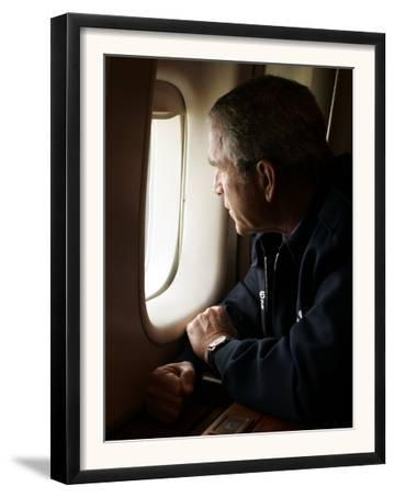 President Bush Looks out the Window of Air Force One Over New Orleans