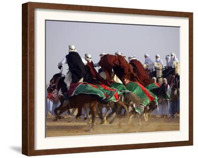 Tunisian Men Ride Their Arab Stallions During a Race the 36th Sahara Festival of Douz