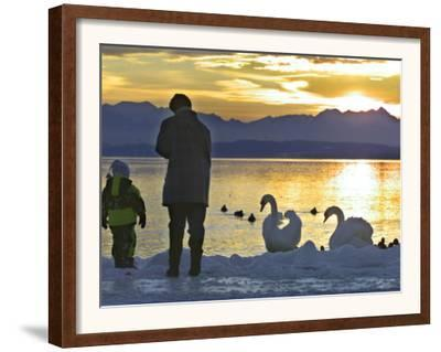 A Mother and Child Feed Water Fowl on the Ice Covered Shores of Lake Chiemsee