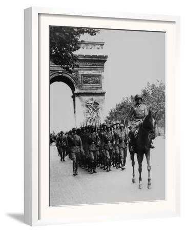 German Occupation Troops March Through the Arc De Triomphe on Champs Elysees
