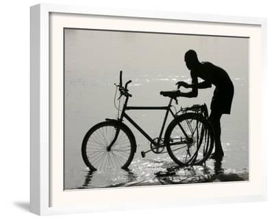 A Chadian Man Washes His Bicycle