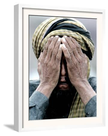 An Elderly Kashmiri Man Finishes Praying on the Outskirts of Balakot, Pakistan