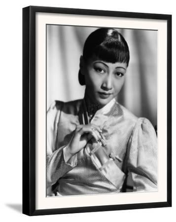 Anna May Wong, in an Orange Nanking Brocade Robe with Sandalwood Fastenings, 1937