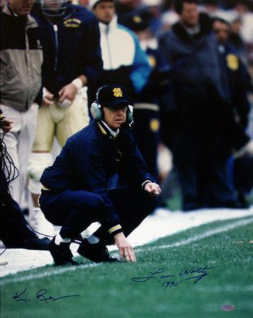 Lou Holtz And Ken Regan Dual Autographed Holtz Inscribed '1990' Crouching On Sideline Photograph