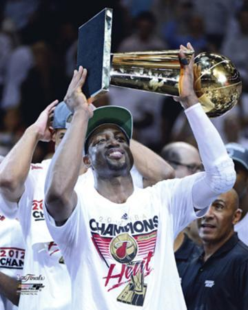 Dwyane Wade with the NBA Championship Trophy