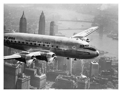 Aircraft Flying over City, 1946